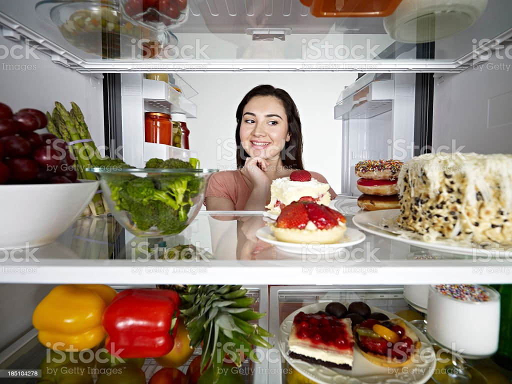Woman Looking at Cake stock photo