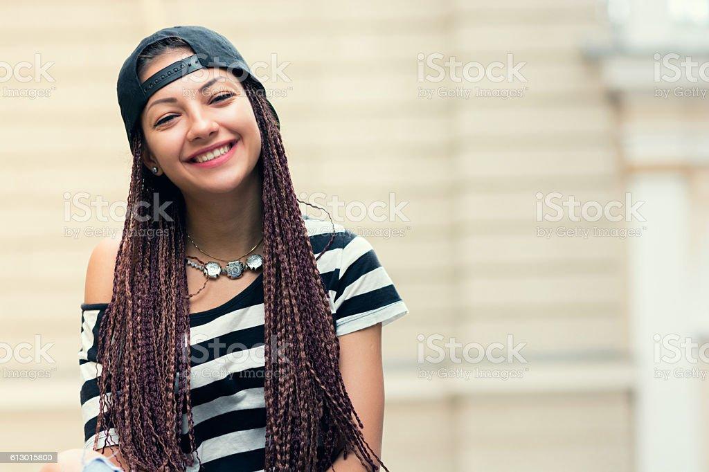woman looking at camera and smiling, hair cornrows stock photo