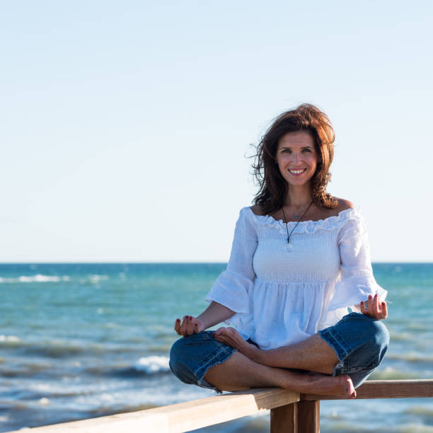 Woman looking at camera in a meditation moment stock photo