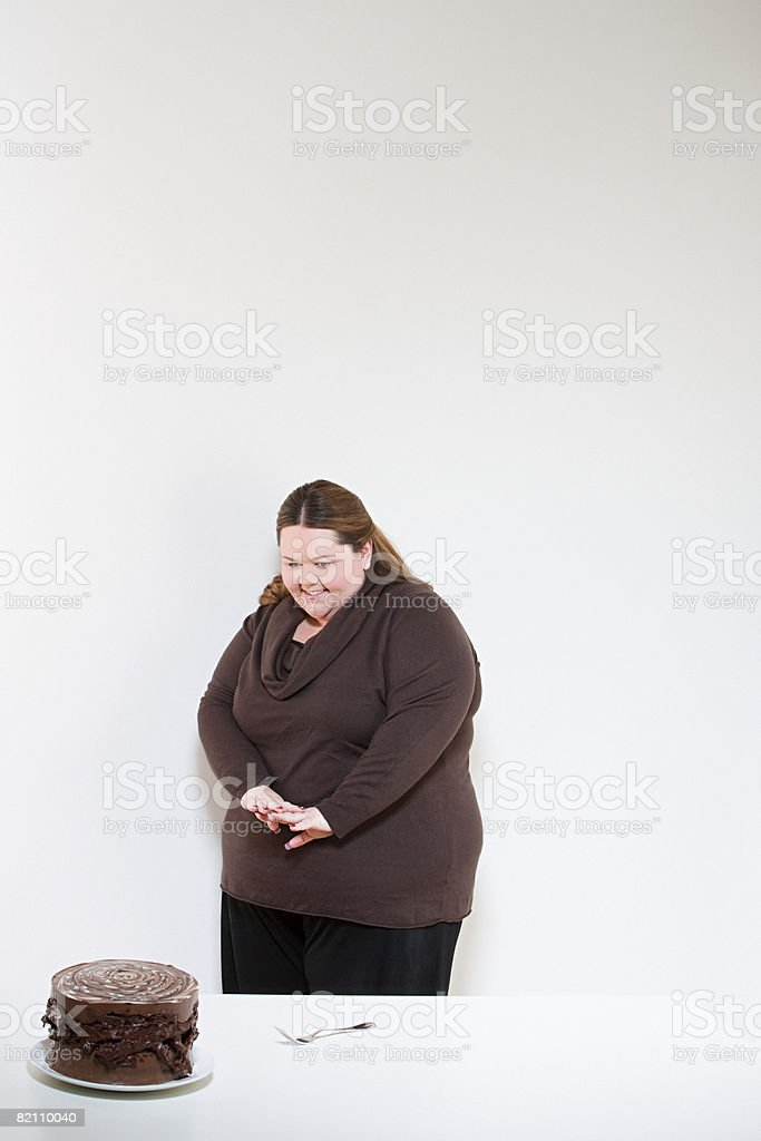 Woman looking at chocolate cake royalty-free stock photo