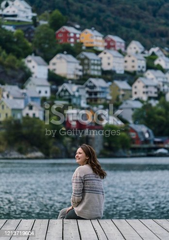 Woman looking at cityscape  of Odda town near fjord  in Norway