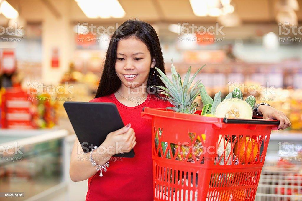 Woman looking at digital tablet royalty-free stock photo