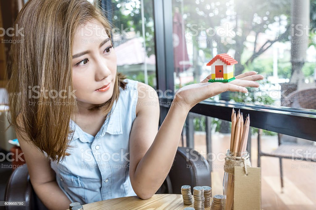 woman looking at dream house stock photo
