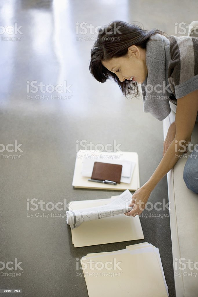 Woman looking at files on floor royalty-free stock photo