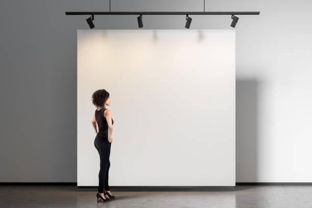 Woman looking at gallery wall stock photo
