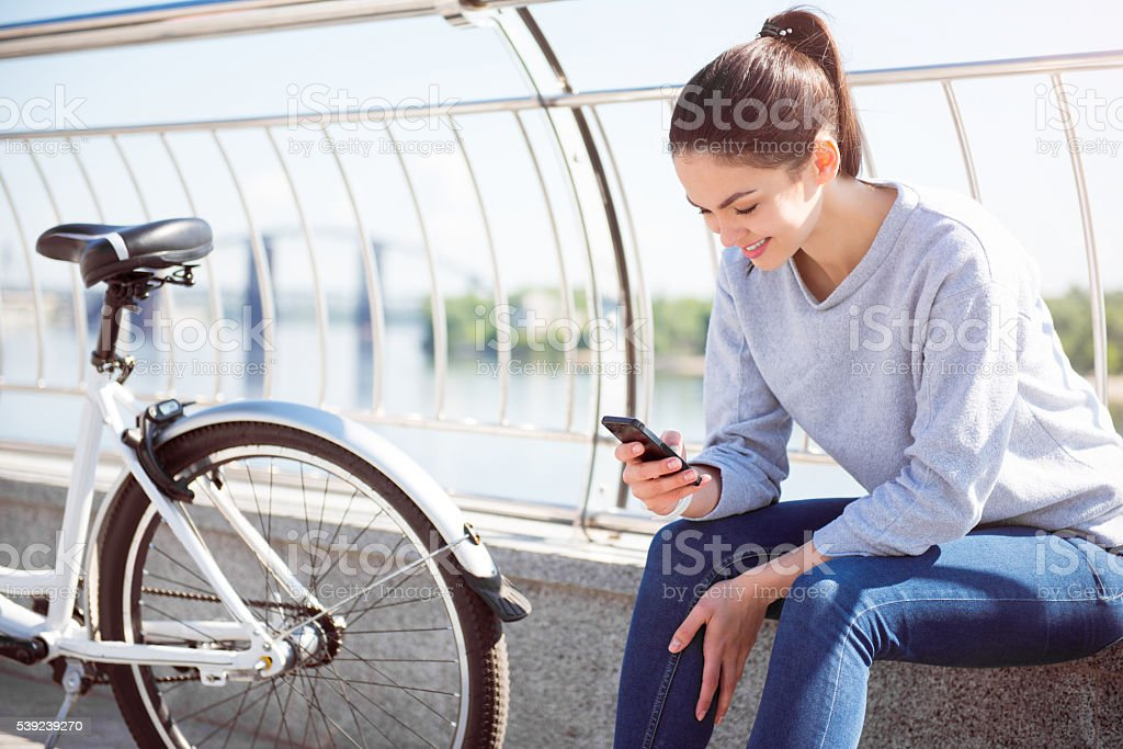 Woman looking at her phone royalty-free stock photo