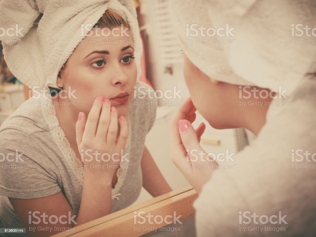 Woman looking at her reflection in mirror royalty-free stock photo