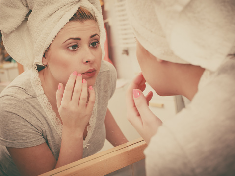 Woman Looking At Her Reflection In Mirror Stock Photo - Download Image Now