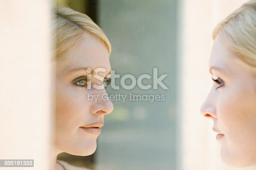 istock Woman looking at her reflection 535191333