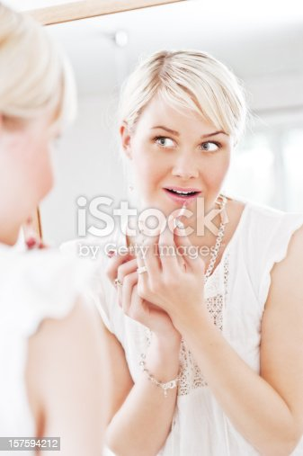 109721176istockphoto Woman looking at herself in a mirror 157594212