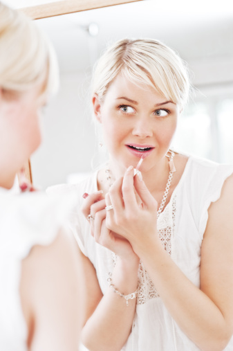 109721176 istock photo Woman looking at herself in a mirror 157594212
