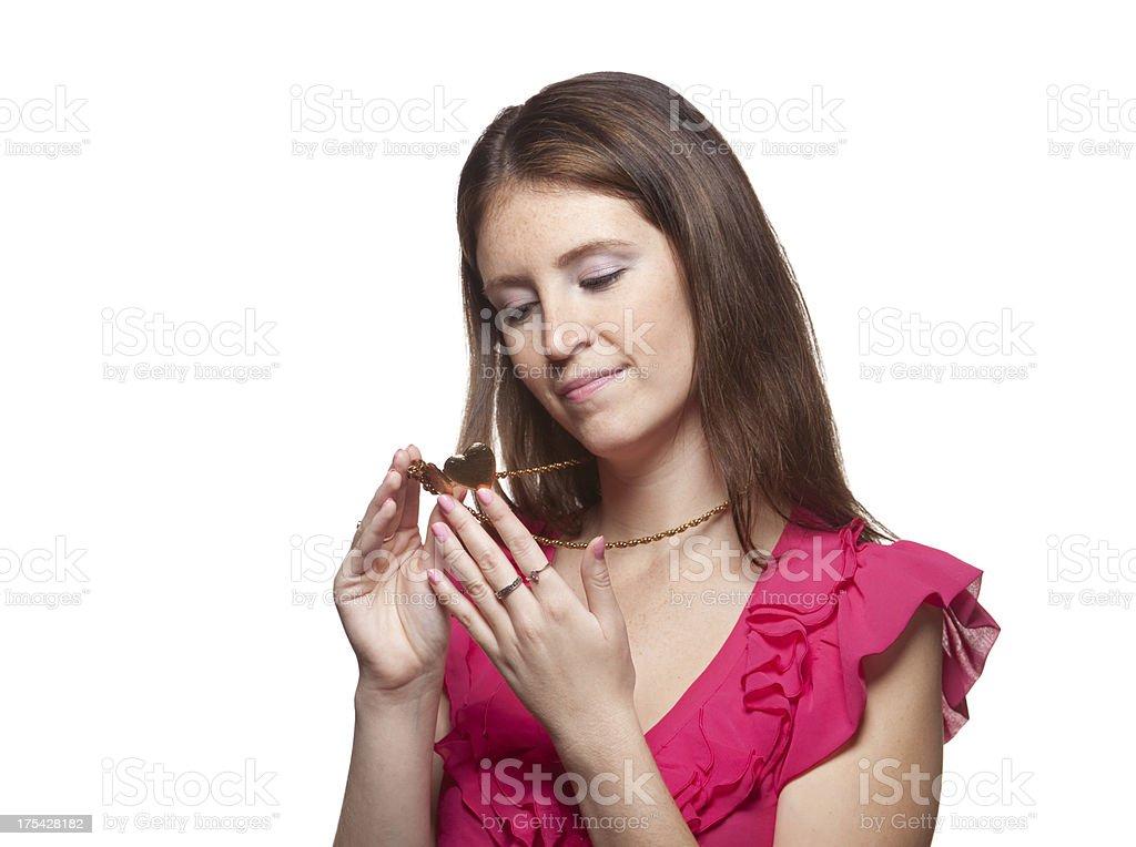Woman Looking At Locket stock photo