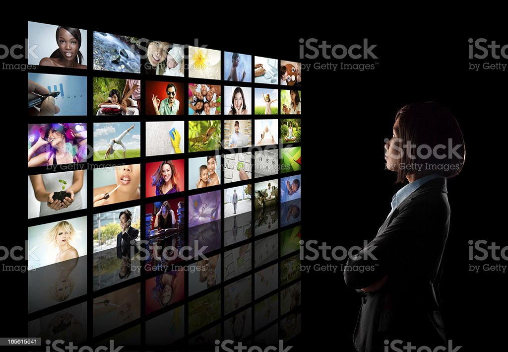 Woman looking at many pictures stock photo
