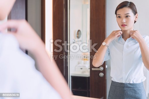 istock woman looking at mirror in the bathroom 859983628