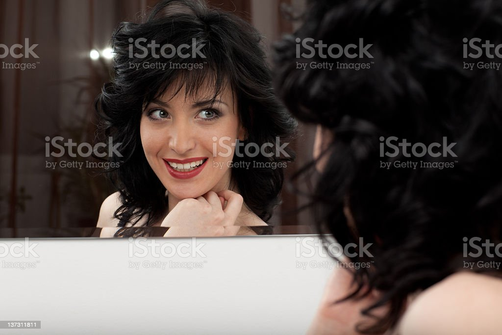 Woman looking at mirror royalty-free stock photo