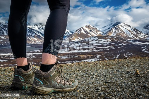 istock Woman looking at mountain range 974476748
