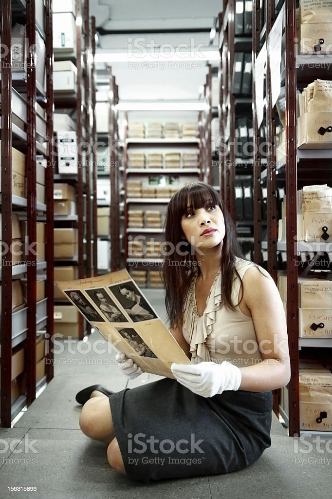 Woman looking at old pictures stock photo