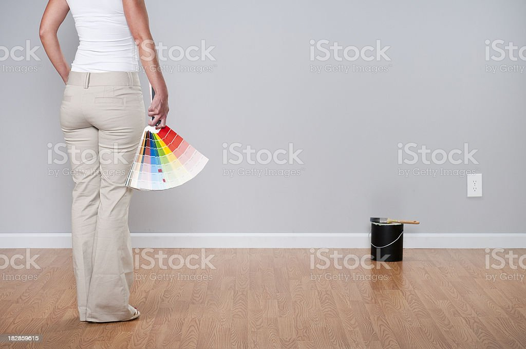 Woman Looking At Paint Chips royalty-free stock photo