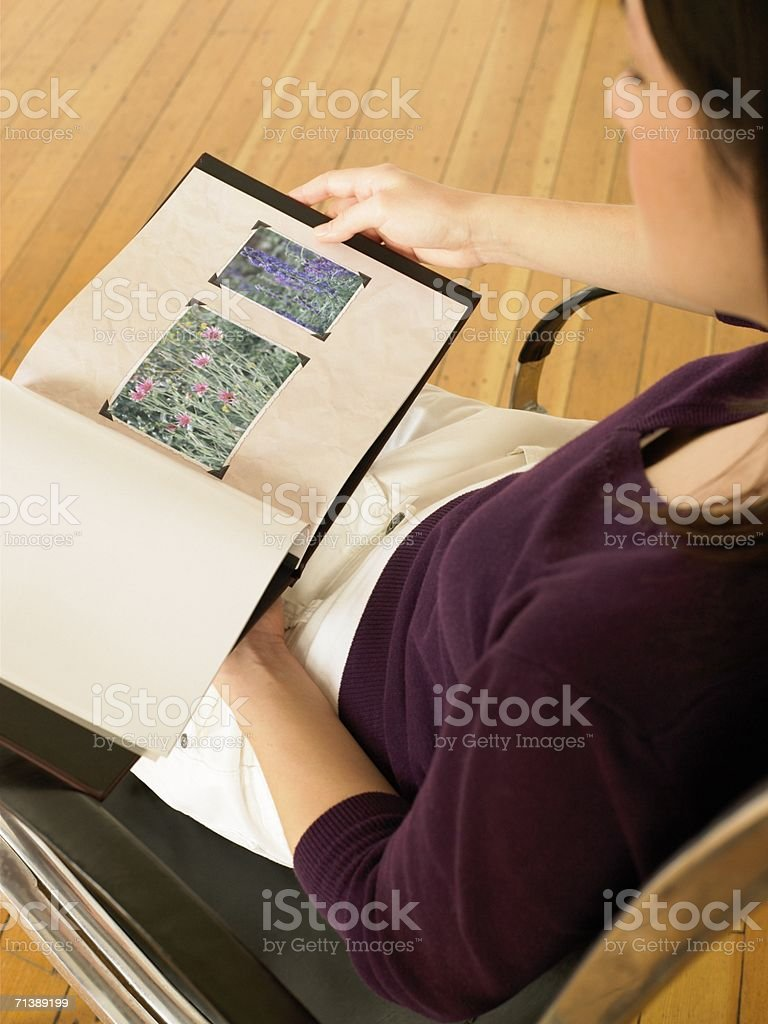 Woman looking at photo album royalty-free stock photo