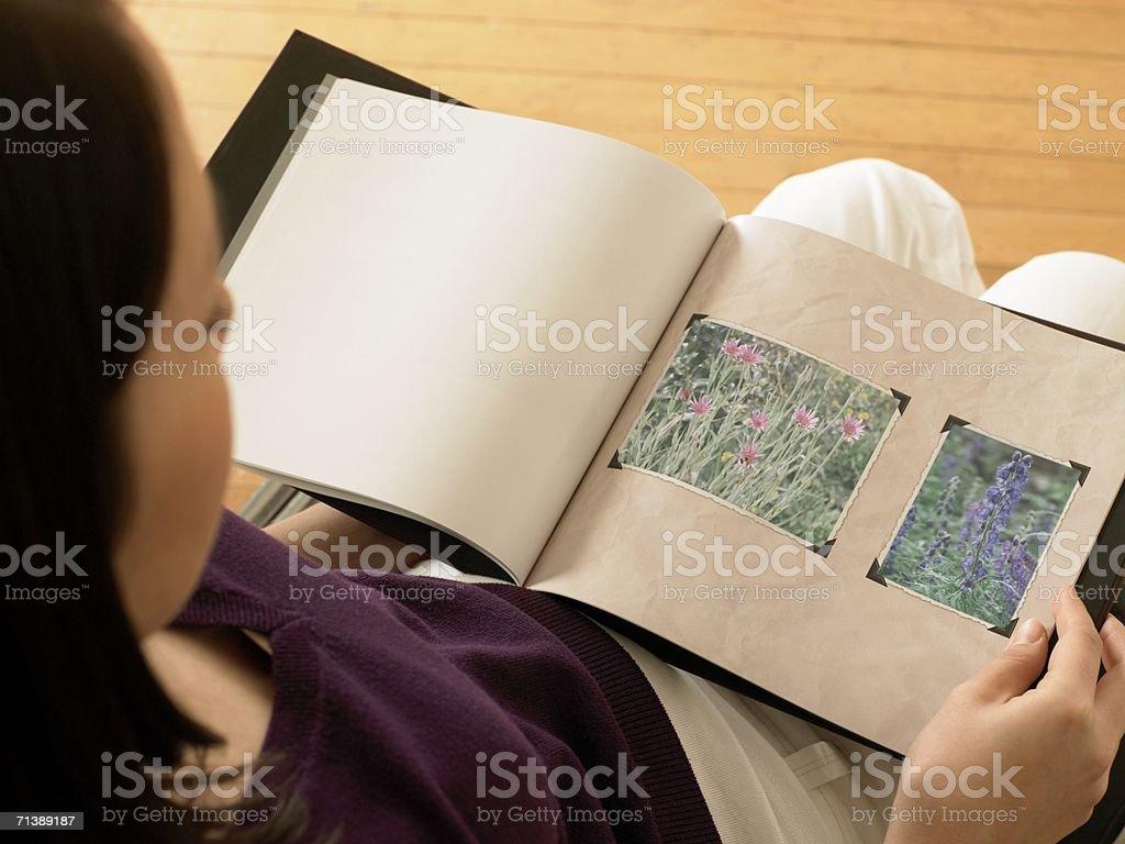 Woman looking at photographs royalty-free stock photo