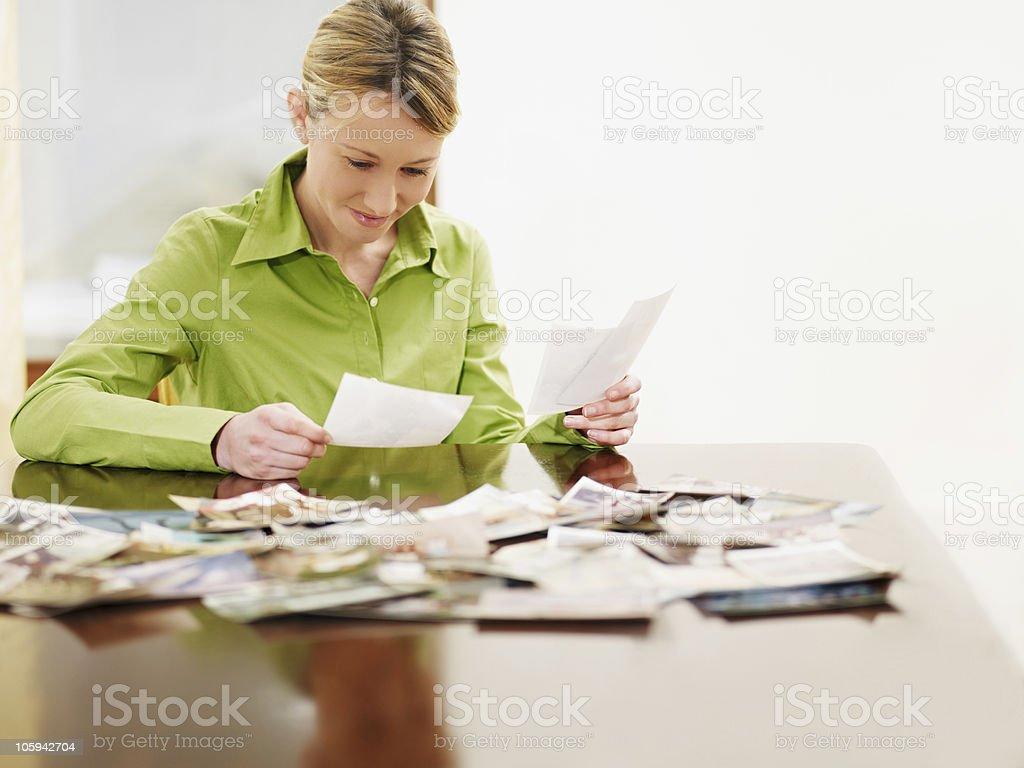 woman looking at photos royalty-free stock photo