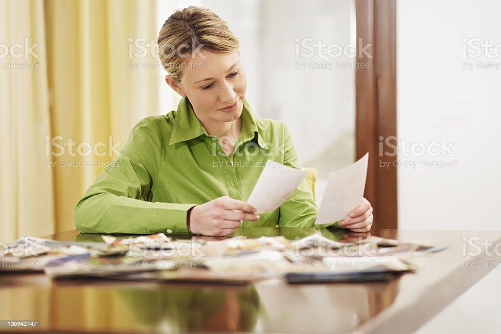 woman looking at photos stock photo