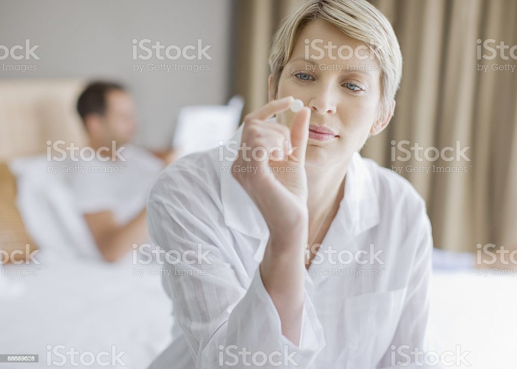 Woman looking at pill royalty-free stock photo