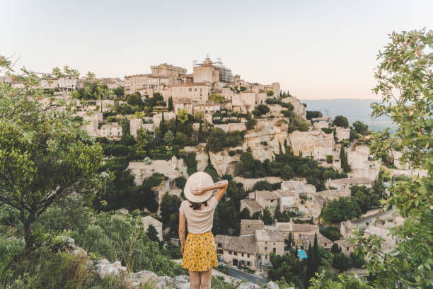 Woman looking at scenic view  of Gordes village in Provence stock photo