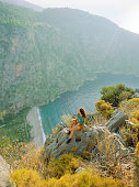 Woman looking at scenic view  of Mediterranean coast in Turkey