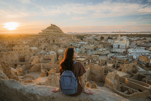 Woman looking at scenic view of Siwa oasis at sunset