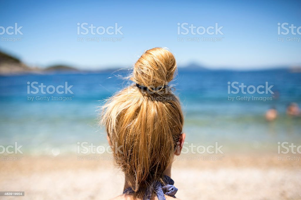 Woman looking at sea stock photo