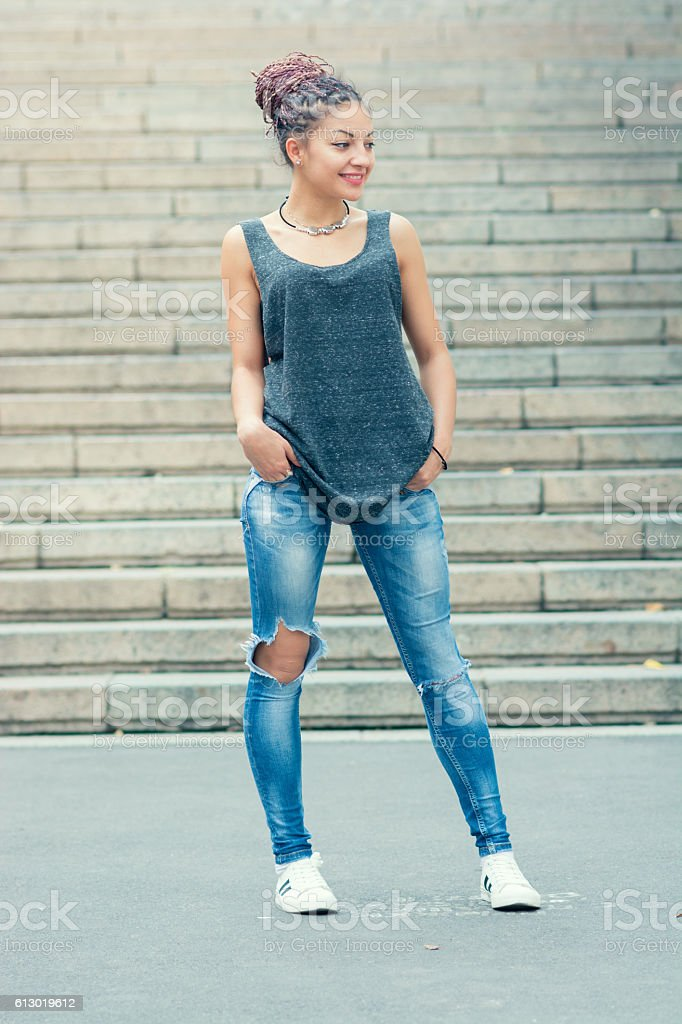 woman looking at side and smiling, hair cornrows stock photo