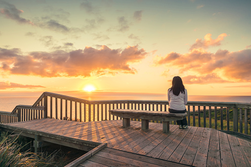 Woman looking at sunset at Hallett Cove boardwalk