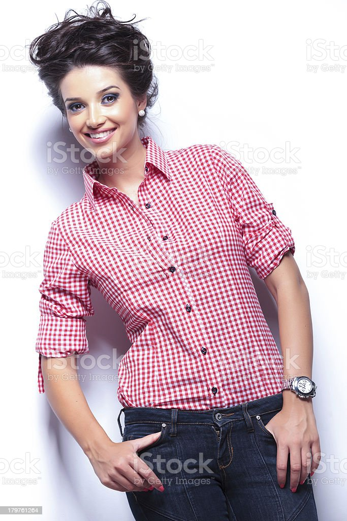 woman looking at the camera with hands in her pockets royalty-free stock photo