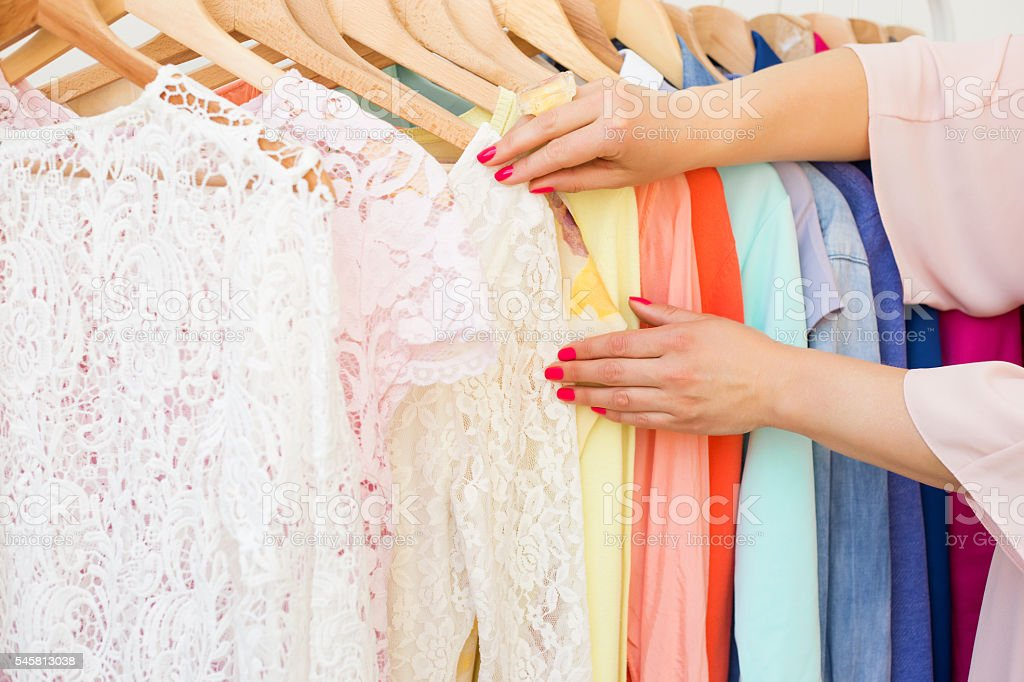 Woman looking at the clothing rack stock photo