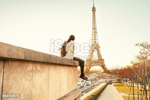 Woman looking at the Eiffel Tower in Paris