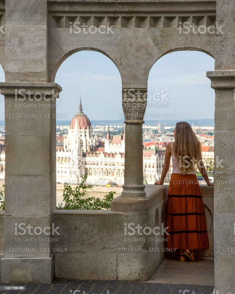 A woman looking at the Hungarian parliament from Fisherman's Bastion stock photo