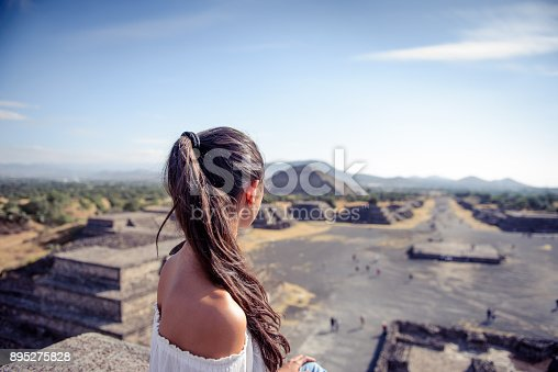 istock Woman looking at the Mexican pyramides. 895275828