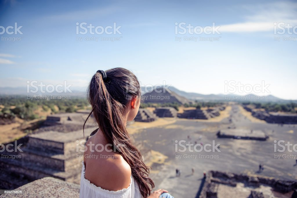 Woman looking at the Mexican pyramides. stock photo