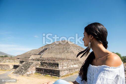 Beautiful woman discovering Mexican pyramids
