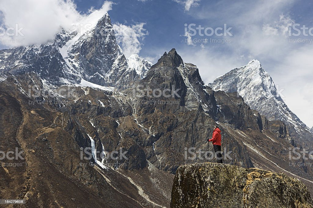 Woman looking at the mountains, Mount Everest National Park royalty-free stock photo
