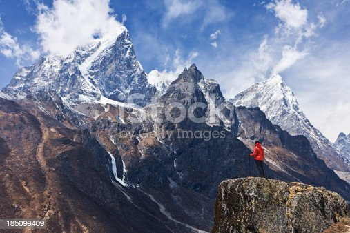 istock Woman looking at the mountains, Mount Everest National Park 185099409