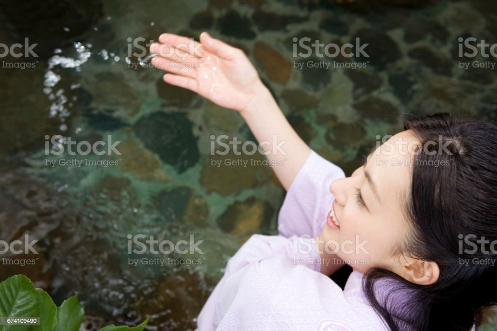 Woman looking at the open-air bath royalty-free stock photo