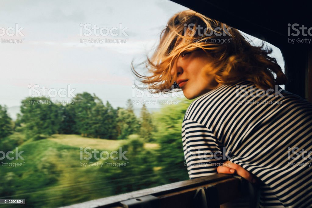Woman looking at the view from train stock photo