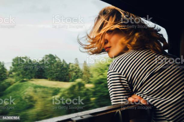 Photo of Woman looking at the view from train