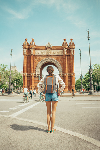Woman looking at Triumphal Arch in Barcelona