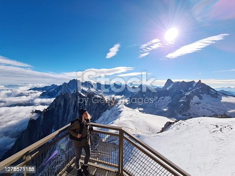 istock Woman looking at view from Aiguille du Midi. Chamonix needles, Mont Blanc, Haute-Savoie, Alps, France 1278571188