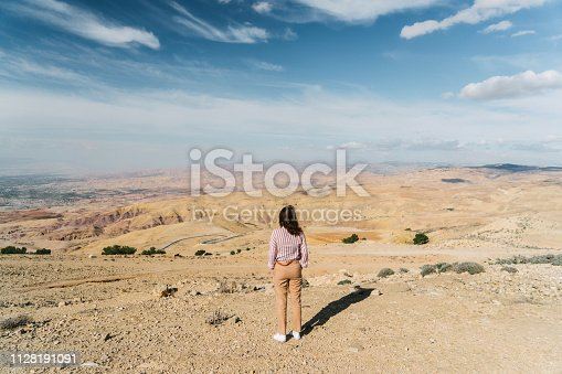 Young Caucasian woman looking at view from Mount Nebo