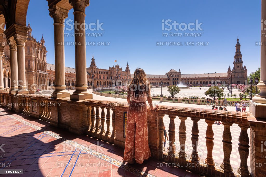 Woman looking at view of Plaza de España in Seville, Spain - Royalty-free Admiration Stock Photo