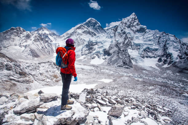 Woman looking at view on Himalayas stock photo